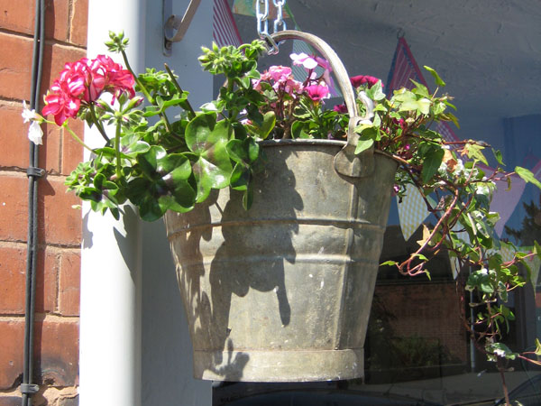 Hanging basket from an old bucket