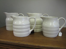 White banded jugs, various prices.