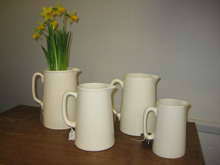 White straight sided jugs, various prices.