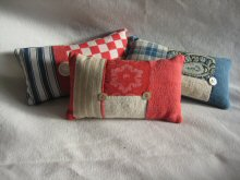 Lavender pincushions in a variety of fabrics