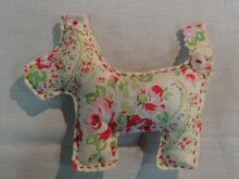 Terrier shaped pincushions in a variety of fabrics